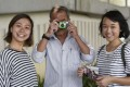 """""""Our City, My Story"""" project co-founders Sharon Lee (left) Stephanie Lau (right) with participant Peter Ng in Admiralty last month. Photo: Xiaomei Chen"""