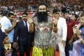Saint Dr. Gurmeet Ram Rahim Singh Ji Insan greets followers at a press conference. Photo: AP