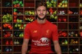 Adam Lallana supports Standard Chartered's Seeing Is Believing international charity.