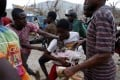 People fight while they assail a truck to try to get food after Hurricane Matthew hit Jeremie, Haiti. Photo: Reuters