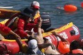 The deceased was pulled from the water near the finish line. Photo: Sam Tsang