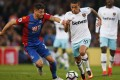 West Ham United's Manuel Lanzini in action with Crystal Palace's Joel Ward. Photos: Reuters