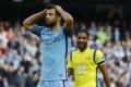 Sergio Aguero rues his failed penalty against Everton. Photo: Reuters