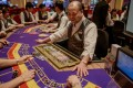 Macau gaming stocks fell sharply, with Galaxy Entertainment down 4.2 per cent to HK$29.3, Sands China falling 3.3 per cent to HK$33.85 and Melco slumping 7.1 per cent to HK$9.55. Photo: AFP