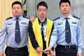 The suspect in the case, who allegedly stabbed his parents to death and then went to an internet bar to play computer games. Photo: SCMP Pictures