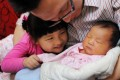 China is now keen for families to have a second child. Incentives include paid paternal leave of up to 30 days. Photo: Imaginechina