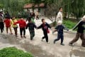 Students walk hand in hand at a special school for blind children in Xian. But half the world's disabled children do not attend school because of a lack of resources. Photo: EPA