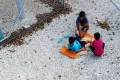 An Amnesty International photo claiming to show children playing near the fence at Australia's detention centre on the Pacific island nation of Nauru. Photo: Reuters