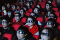 Equipment in China's cinemas is relatively new and advanced with 86 per cent of screens configured for 3D films. Bloomberg reported in 2015 that around 15 new cinema screens opened in China each day. Photo: AFP
