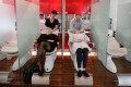 A hair salon in Beijing. In a Pew survey, nine out of 10 people in China describe the economy as being in good shape. Photo: Reuters