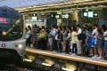 People wait on the platform of Kowloon Tong Station after a service delay caused by damaged equipment. Photo: Dickson Lee