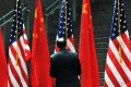 Chinese and US flags fly together at recent trade talks between the nations. Photo: AFP