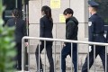 Wang Baoqiang (third from left) walks into the Beijing court before the start of the divorce hearing on Tuesday. Photo: SCMP Pictures