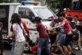 A police van runs over protesters during a protest in front of the US Embassy in Manila. Photo: EPA