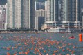 More than 3,000 swimmers take to the waters between Lei Yue Mun and Quarry Bay Park for the annual cross-harbour swim on October 16. Photo: AFP
