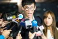 Pro-independence lawmakers Sixtus Leung and Yau Wai-ching speak to the press outside the High Court in Hong Kong on October 18. Photo: AFP