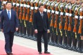 President Xi Jinping (left) pictured with Rodrigo Duterte as they inspect an honour guard in Beijing. Photo: Simon Song