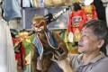 Master puppeteer Wong Fai with a monkey puppet. Photo: Rachel Cheung