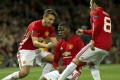Manchester United's Paul Pogba celebrates with Matteo Darmian (left) and Juan Mata (right) after scoring the third goal in their Europa League tie against Fenerbahce at Old Trafford. Photo: EPA