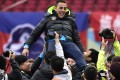Tianjin Quanjian head coach Fabio Cannavaro celebrate with team supporters after the club won the China League One championship. Photos: Xinhua