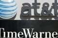 The logos of AT&T and Time Warner as the two giants are reported to be in buyout talks. Photo: AFP