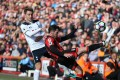 AFC Bournemouth's Adam Smith, front, and Tottenham Hotspur's Christian Eriksen compete for the ball. Photo: AP