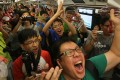 Some commuters were very happy to be on the first train from Whampoa. Photo: Sam Tsang