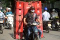 A delivery man transporting crates of beer in Hanoi. Photo: AFP