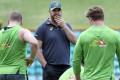 Australia coach Michael Cheika speaks to his players during a training session in Sydney on Thursday. Photo: AFP