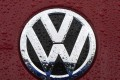 The VW emblem is seen on a Volkswagen for sale at a dealership in Gaithersburg, Maryland. A US judge on October 25, 2016 granted final approval for a $14.7 billion class action settlement in Volkswagen's diesel emissions cheating scandal. Photo: AFP