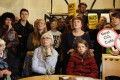 Residents of Harmondsworth gather in a pub listen to the decision on Tuesday to build a third runway for Heathrow Airport, effectively sentencing the village to demolition. Photo: AP