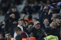Rival supporters separated by stewards shout and gesture at each other during the EFL Cup match between West Ham United and Chelsea at the London Stadium. Photo: AP