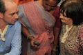 Cherie Blair (R), wife of former British prime minister Tony Blair and chairperson of the Cherie Blair Foundation for Women, and Vodafone Foundation's global director Andrew Dunnett are briefed on a mobile application during their visit to an agricultural processing centre in India. Photo: Sam Panthaky/AFP