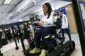 Carol Ng Cho-yu seated on a wheelchair designed by seven students from HKUST won silver in the world's first Olympics for bionic athletes, Cybathlon. 26OCT16 SCMP/Jonathan Wong