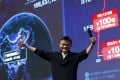 Alibaba founder Jack Ma gestures in front of a screen showing real-time data of transactions during last year's Singles' Day festival, which saw a 60 per cent year on year increase in gross merchandise volume to 91.2 billion yuan. Photo: Reuters