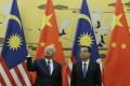 Malaysian Prime Minister Najib Razak and Premier Li Keqiang attend a signing ceremony at the Great Hall of the People in Beijing on Tuesday. Photo: AFP