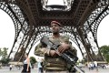 An armed French soldier patrols under the Eiffel tower in Paris. Photo: AFP