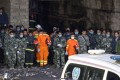 Rescuers honour the victims at the Jinshangou coal mine in Chongqing. Thirty-three miners have been confirmed dead after an explosion at the mine on Monday morning.Photo: Xinhua