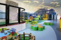 Gateway Apartments, atop Harbour City, offers a range of family-friendly services and facilities, such as a children's playroom.