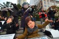 Protesters wearing masks of South Korean President Park Geun-Hye, front, and her confidante Choi Soon-Sil protest in central Seoul. Photo: AFP