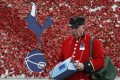 A Chelsea Pensioner pays his respects at the Poppy Wall outside Tottenham Hotspur's White Hart Lane. Photo: Reuters