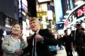 People dress as US presidential candidates Hillary Clinton and Donald Trump for a Halloween parade in Tokyo. Photo: AFP