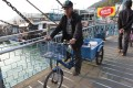 A local rides bicycle over a bridge in Tai O. Photo: SCMP Pictures