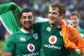 Rob Kearney and Jamie Heaslip of Ireland celebrate following their team's 40-29 victory against New Zealand at Soldier Field. Photo: AFP