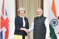 India's Prime Minister Narendra Modi shakes hands with Britain's Prime Minister Theresa May prior to a meeting in New Delhi. Photo: AFP