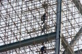 Labourers work on scaffolding at a construction site in Beijing. Photo: Reuters