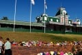 People leave floral tributes outside the main entrance to Dreamworld on Australia's Gold Coast. Photo: Reuters
