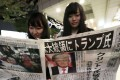 Women read about Donald Trump's victory in the US presidential election, in Nagoya in central Japan on Wednesday. Photo: Kyodo