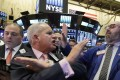 Executive Floor Governor Rudy Mass, centre, and specialist Peter Giacchi, right, call out prices for Weatherford, on the floor of the New York Stock Exchange as stocks moved higher late on Wednesday. Photo: AP