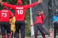 Captain Babar Hayat celebrates after Nadeem Ahmed takes a wicket against Papua New Guinea. Photo: Cricket Hong Kong